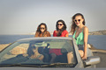Four girls in a car - PhotoDune Item for Sale