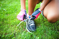 female runner and athlete preparing shoes for jogging