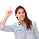 Pretty hispanic lady pointing up and smiling - PhotoDune Item for Sale
