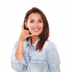 Pretty hispanic woman with call gesture - PhotoDune Item for Sale