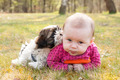 Baby and puppy on the grass - PhotoDune Item for Sale