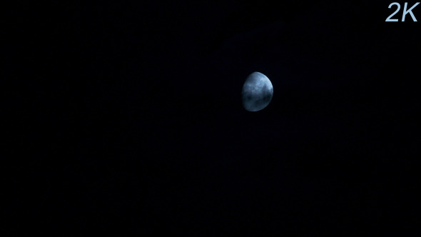 Moon Moving Between Clouds 2