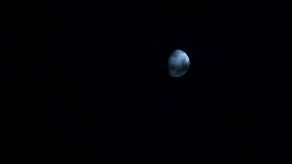 Moon Moving Between Clouds 3