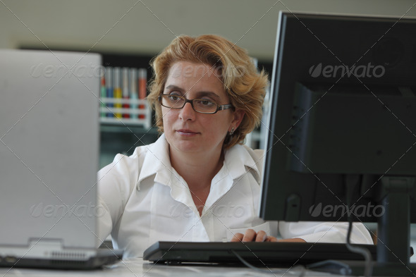 Researcher with Computers  - Stock Photo - Images