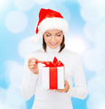 smiling woman in santa helper hat with gift box - PhotoDune Item for Sale