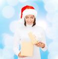 smiling woman in santa helper hat opening gift box - PhotoDune Item for Sale