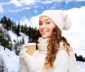 woman in hat with takeaway tea or coffee cup - PhotoDune Item for Sale