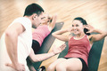 group of smiling women doing sit ups in the gym - PhotoDune Item for Sale