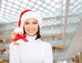 smiling woman in santa helper hat and jingle bells - PhotoDune Item for Sale