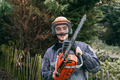 Professional gardener with chainsaw - PhotoDune Item for Sale