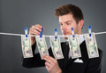 Businessman Drying Dollar Bills On Clothesline - PhotoDune Item for Sale