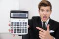 Shocked Businessman Looking At Calculator - PhotoDune Item for Sale