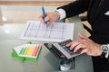 Businessman Calculating Energy Efficiency Rate - PhotoDune Item for Sale