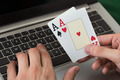 Businessman Holding Cards While Using Laptop - PhotoDune Item for Sale