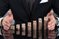 Businessman Protecting Economy Blocks On Stacked Coins - PhotoDune Item for Sale