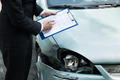 Insurance Agent Inspecting Car After Accident - PhotoDune Item for Sale