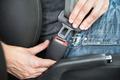 Man Fastening Seat Belt In Car - PhotoDune Item for Sale