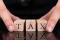 Businessman Holding Tax Blocks - PhotoDune Item for Sale