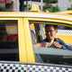 taxi driver driving car happy client paying money - PhotoDune Item for Sale