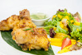 chicken in curry with salad and sauce on a white background in restorne - PhotoDune Item for Sale
