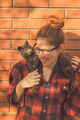 Happy cute hipster girl playing with her cat - PhotoDune Item for Sale