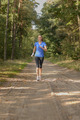 Athletic woman out jogging in a forest - PhotoDune Item for Sale