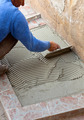 Tiler works with flooring. - PhotoDune Item for Sale