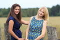 Blonde and brunette girls near wood country fence - PhotoDune Item for Sale