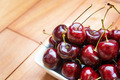 Fresh cherries in bowl on table - PhotoDune Item for Sale