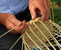 Elder's hands working the cane to create a wicker basket - PhotoDune Item for Sale