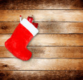 Red christmas boot with gifts on background wooden wall - PhotoDune Item for Sale