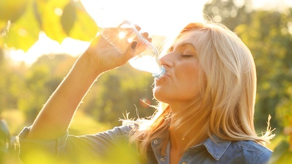 Woman Is Drinking Water In The Sun