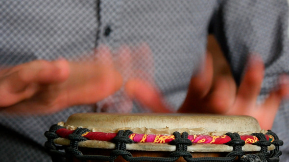 Percussion Drummer Performing With Bongos