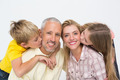 Happy family smiling and showing affection on white background