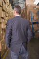 Rear view of male manager standing in the warehouse