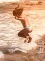 Child jumping on the beach - PhotoDune Item for Sale