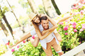 Romantic couple doing piggyback in the park - PhotoDune Item for Sale
