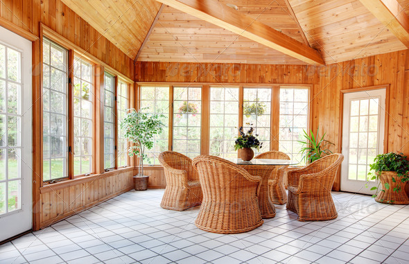 PhotoDune Wooden Wall Sun Room Interior with Wicker Furniture 924987
