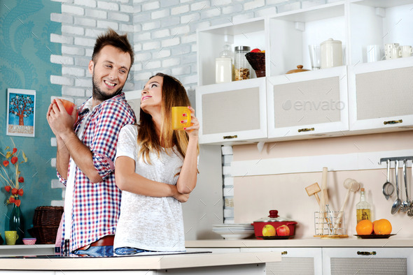 Tea Ceremony Young Couple In Love Drinking Hot Tea While Standing And Cooking In The Kitchen Clamps To Each Other And Laughing At Each Other Stock Images Page Everypixel