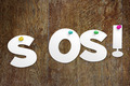 Word SOS cut out of paper - PhotoDune Item for Sale