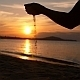 Female Hand Pouring Sand on Beach at Sunset - VideoHive Item for Sale