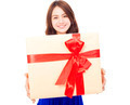 closeup of happy young woman holding a gift box over white background - PhotoDune Item for Sale