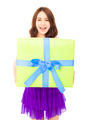 happy young woman holding a gift box over white background - PhotoDune Item for Sale