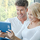 Happy Couple Using Touch Pad - VideoHive Item for Sale