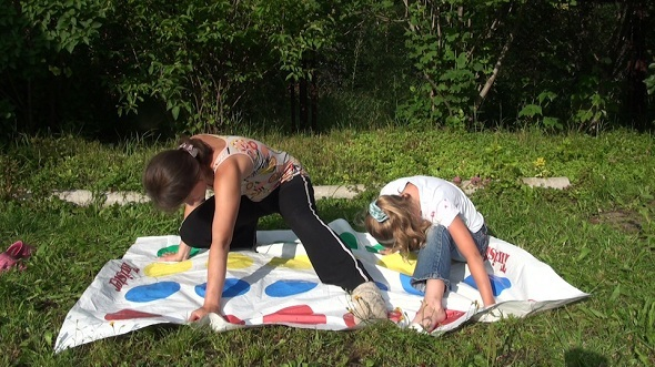 Mother With Her Daughter Play Twister 1