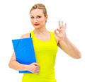 smiling woman with OK gesture and folder - PhotoDune Item for Sale