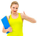 smiling woman with thumbs up gesture and folder - PhotoDune Item for Sale