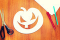 Halloween pumpkin cut out of paper lying on the table - PhotoDune Item for Sale