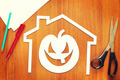 Halloween pumpkin into home cut out of paper lying on the table - PhotoDune Item for Sale