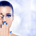 Beautiful Girl in Blue with Hands on Her Face. Nail Art and Make - PhotoDune Item for Sale